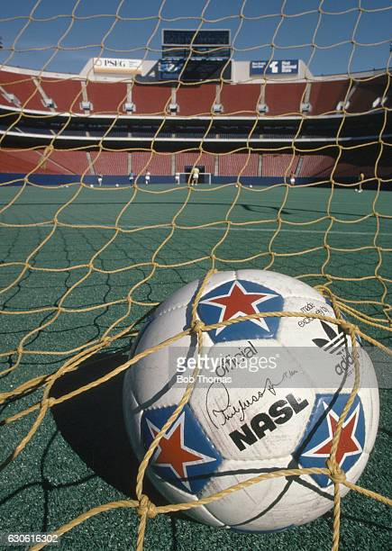 The official North American Soccer League ball in the net at Giants Stadium in New Jersey whose playing field has an Astroturf surface circa 1980