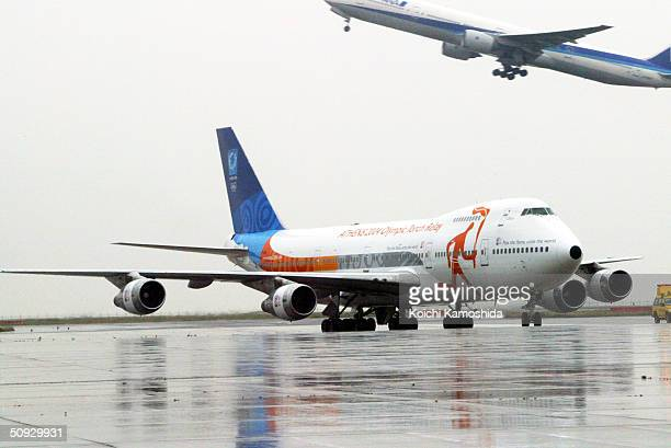 The official Olympic airplane carrying the Olympic flame arrives at Tokyo International Airport on June 6 2004 in Tokyo Japan The 53kilometer relay...