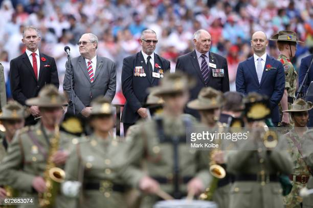 The official party are seen on stage during the Anzac Day ceremony before the round eight NRL match between the Sydney Roosters and the St George...