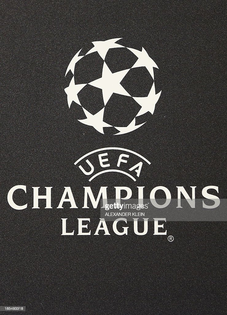 The official UEFA Champions League logo is seen during a press conference of Austrian footbal club Austria Wien ahead of a training session in Vienna on October 21, 2013 on the eve of their group stage UEFA Champions League football match between Austria Vienna and Atletico de Madrid.
