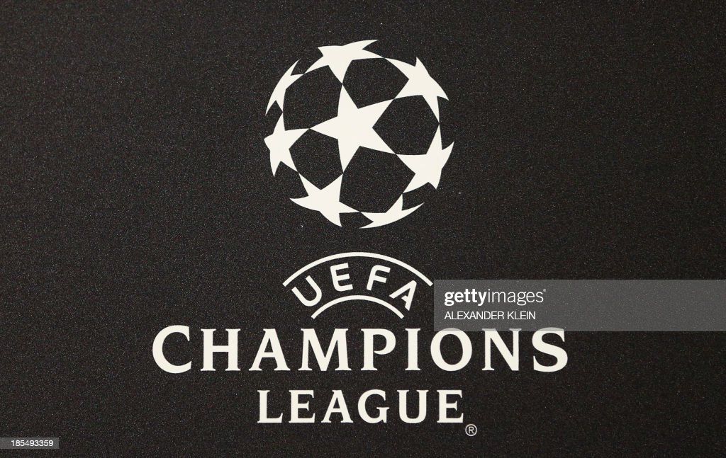 The official UEFA Champions League logo is seen during a press conference of Austrian football club Austria Wien ahead of a training session in Vienna on October 21, 2013 on the eve of their group stage UEFA Champions League football match between Austria Vienna and Atletico de Madrid.