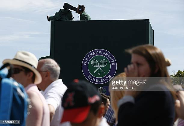 The official Wimbledon Championships logo is seen displayed as spectators watch a match on day one of the 2015 Wimbledon Championships at The All...