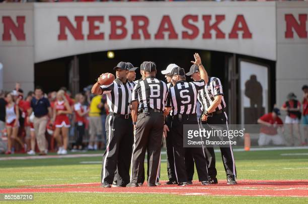 The officials ready for the start of the second half in the game between the Nebraska Cornhuskers and the Rutgers Scarlet Knights at Memorial Stadium...