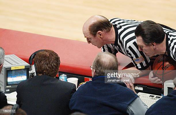 The officials watch an instant replay during the Big Ten Men's Basketball Tournament between the Indiana University Hoosiers and the Pennsylvania...