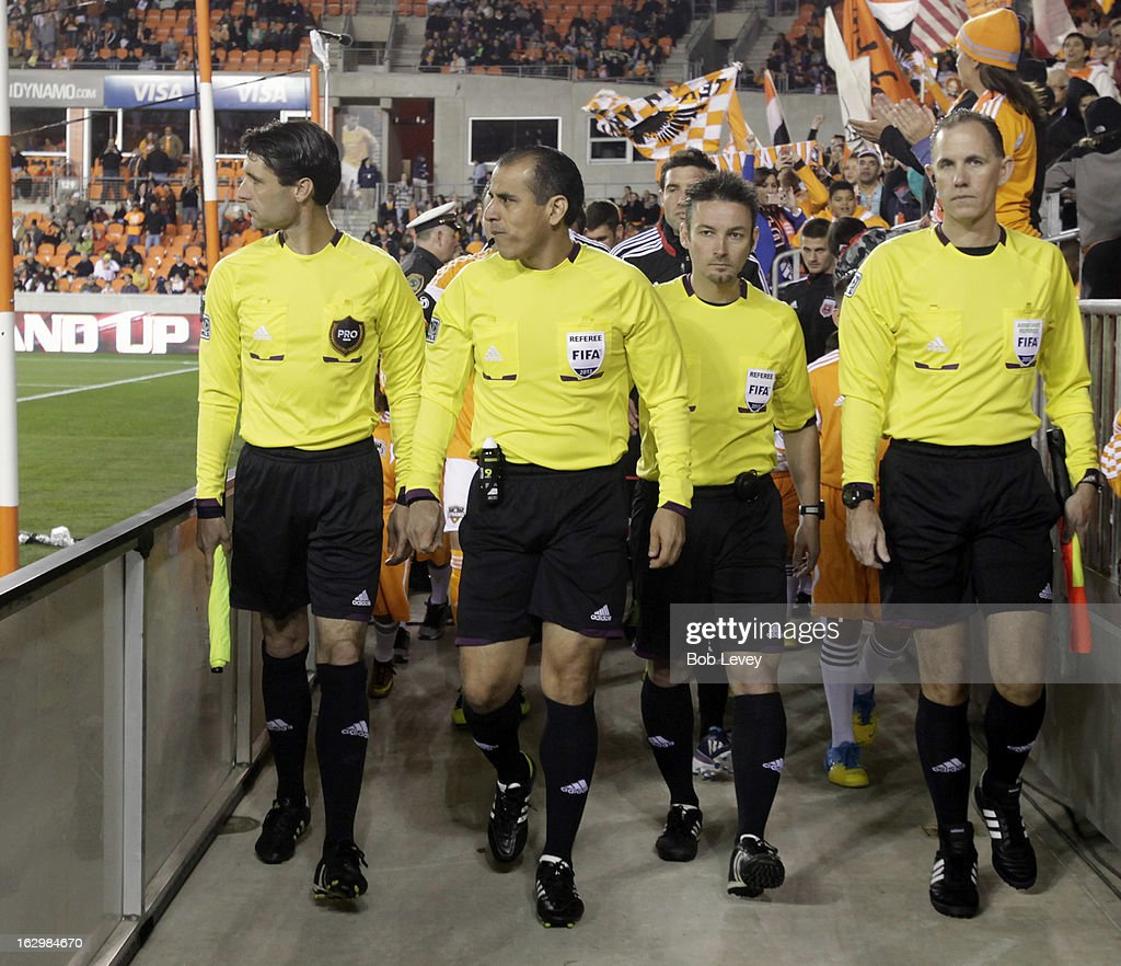 The officias take the field during first half action at BBVA Compass Stadium on March 2, 2013 in Houston, Texas. Houston won 2-0.