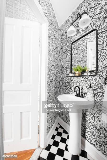 The offkitchen powder room in the Hoburg family's renovated Capitol Hill rowhouse on July 26 2017 A Washington family makes a modest 100yearold three...