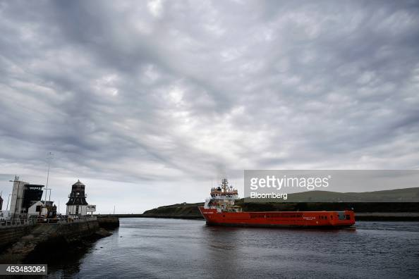 The offshore supply ship Normand Flipper operated by Solstad Flipper ASA passes the harbour control tower far left as it sails out of Aberdeen...