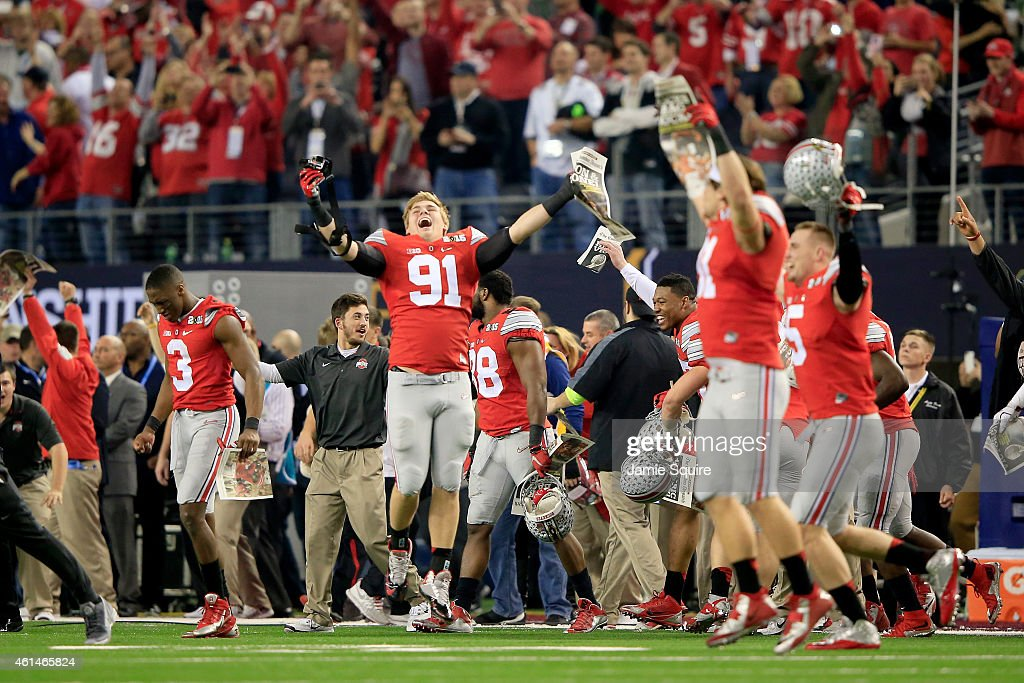 The Ohio State Buckeyes bench celebrates after defeating the Oregon Ducks 42 to 20 in the College Football Playoff National Championship Game at ATT...