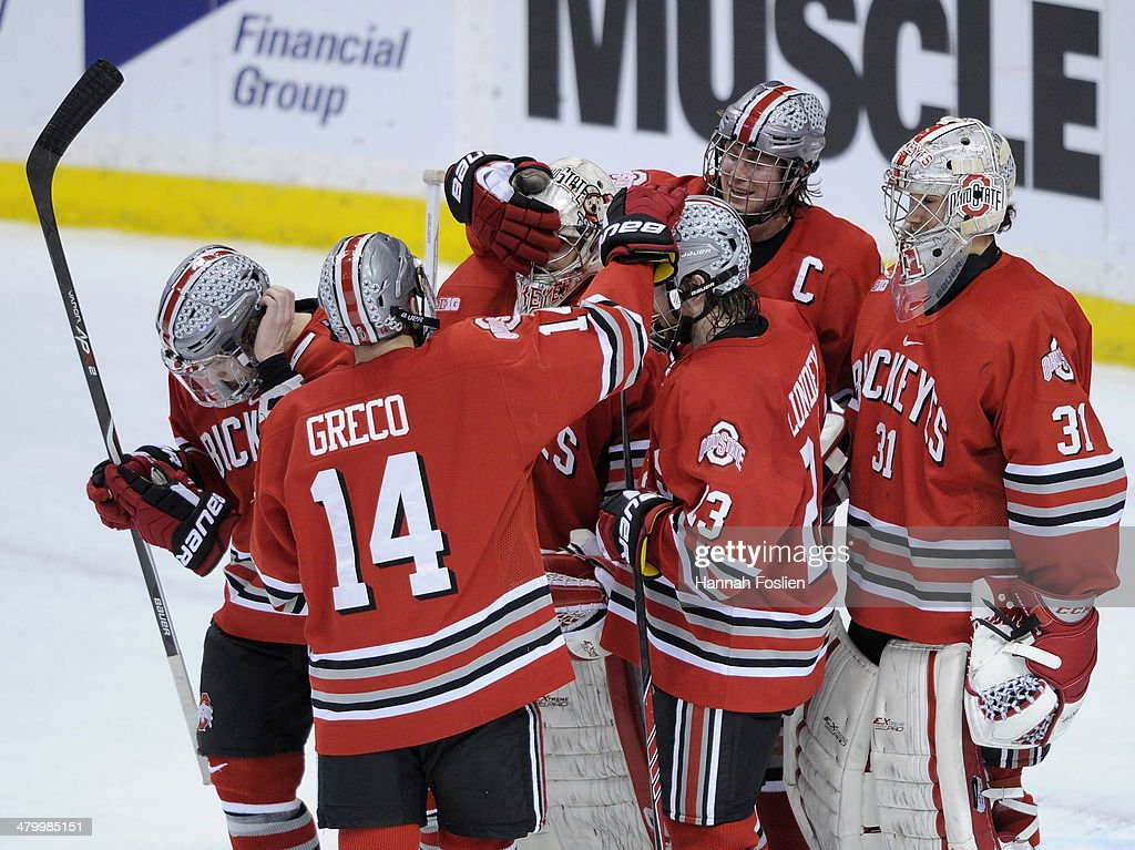 The Ohio State Buckeyes celebrate a win of the semifinal game of the Big Ten Men's Ice Hockey Championship against the Minnesota Golden Gophers on March 21, 2014 at Xcel Energy Center in St Paul, Minnesota. The Ohio State Buckeyes defeated the Minnesota Golden Gophers 3-1.