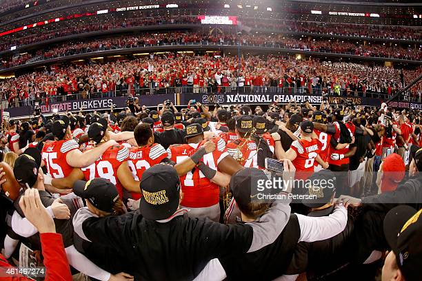 The Ohio State Buckeyes celebrate after defeating the Oregon Ducks 42 to 20 in the College Football Playoff National Championship Game at ATT Stadium...