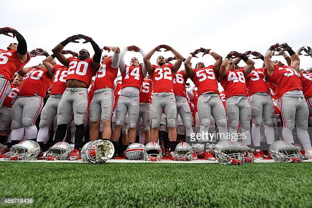 The Ohio State Buckeyes celebrate their 4228 victory over the Michigan Wolverines by performing their alma mater song Carmen Ohio at Ohio Stadium on...