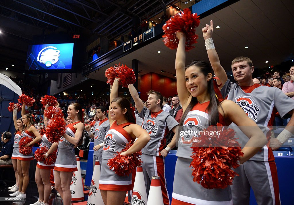 The Ohio State Buckeyes cheerleaders perform on the sideline in the first half against the Iowa State Cyclones during the third round of the 2013 NCAA Men's Basketball Tournament at UD Arena on March 24, 2013 in Dayton, Ohio.