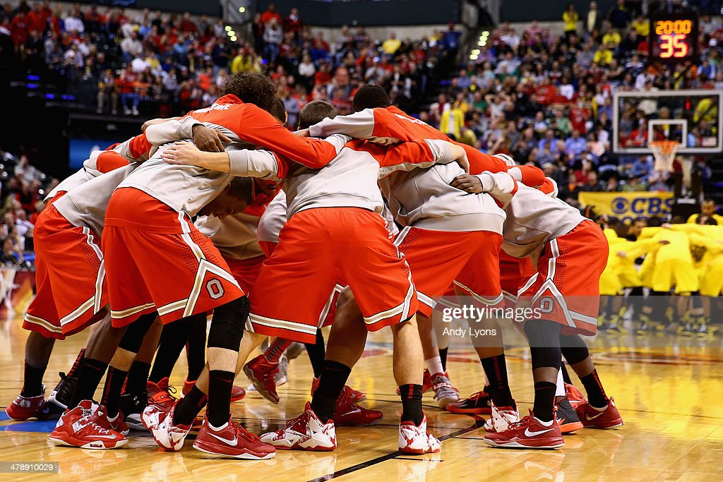 The Ohio State Buckeyes huddle up before playing in the Big Ten Basketball Tournament Semifinal game against the Michigan Wolverines at Bankers Life Fieldhouse on March 15, 2014 in Indianapolis, Indiana.
