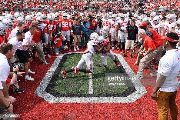 The Ohio State Buckeyes perform the Circle Drill at midfield before the start of their annual Ohio State Spring Game at Ohio Stadium on April 18 2015...
