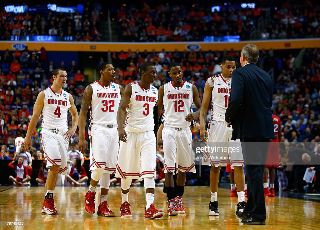 The Ohio State Buckeyes walk to the bench during the second round of the 2014 NCAA Men's Basketball Tournament against the Dayton Flyers at the First...