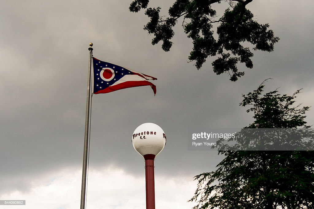The Ohio state flag waves in the wind with the Firestone Country Club water tower in the background during the second round of the World Golf Championships-Bridgestone Invitational at Firestone Country Club on July 1, 2016 in Akron, Ohio.