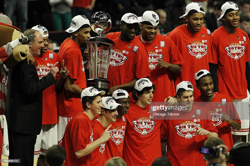 The Ohio State men's basketball team pose for a photograph after defeating Wisconsin, 50-43, in the finals of the men's Big Ten basketball tournament at the United Center in Chicago, Illinois, Sunday, March 17, 2013.