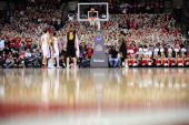 The Ohio State student section raises their arms to form O's as a player shoots free throw during the game against Iowa on January 12 2014 at Value...