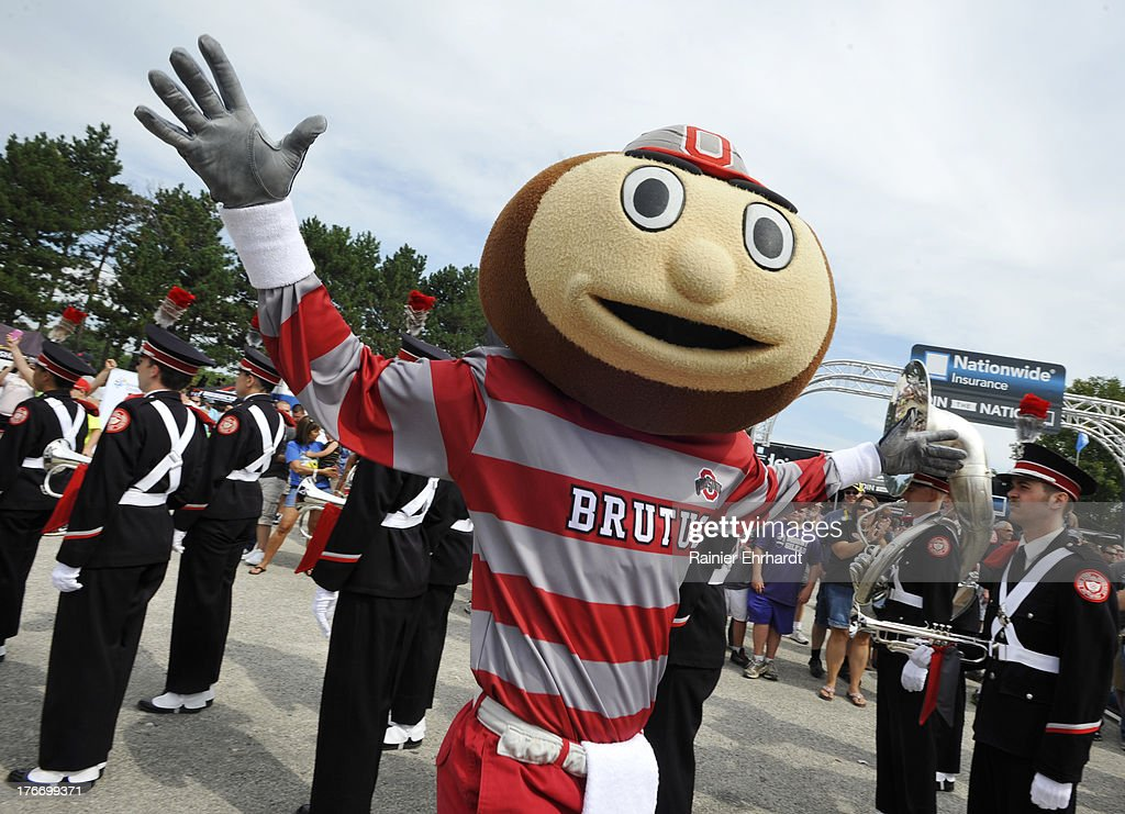The Ohio State University mascot Brutus performs with the marching band before the Nationwide Children's Hospital 200 at Mid-Ohio Sports Car Course on August 17, 2013 in Lexington, Ohio.
