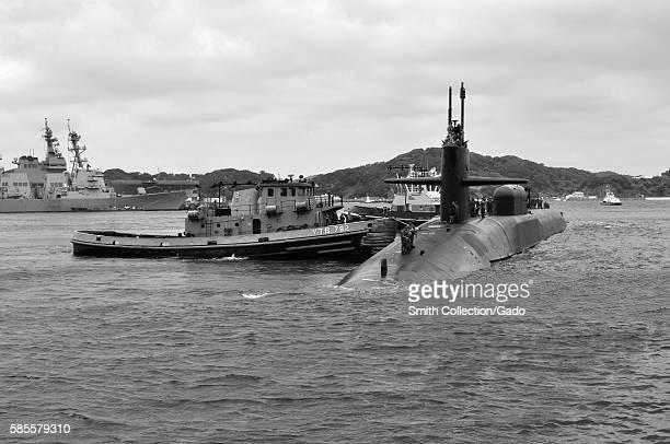 The Ohioclass guidedmissile submarine USS Michigan SSGN 727 arrives at Fleet Activities Yokosuka as part of its deployment to the western Pacific...