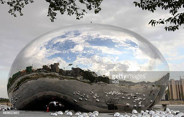 The oil bubbles sculpture at Well No1 is seen on August 9 2015 in Karamay Xinjiang Uygur Autonomous Region of China Crude oil flow spurted out of the...