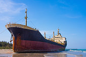 The oil tanker hit by waves crashing ashore