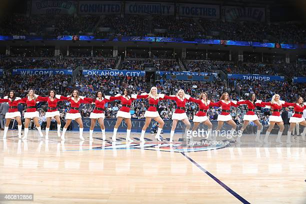 The Oklahoma City Thunder dance team performs during the game against the Portland Trail Blazers on December 23 2014 at Chesapeake Energy Arena in...