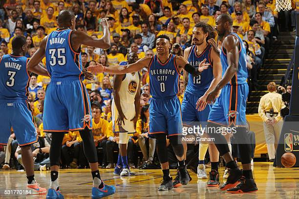 The Oklahoma City Thunder high five each other after a play against the Golden State Warriors during Game One of the Western Conference Finals during...