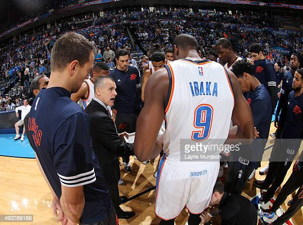 The Oklahoma City Thunder huddle around Head Coach Billy Donovan against the Denver Nuggets during a preseason game on October 18 2015 at Chesapeake...