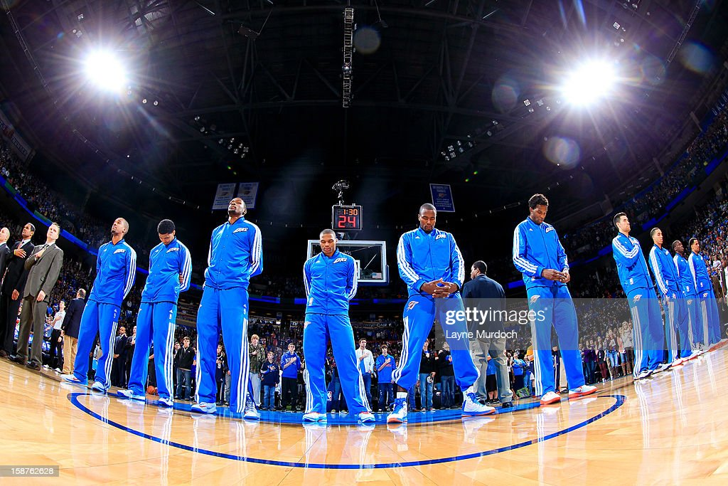 The Oklahoma City Thunder listen to the National Anthem before playing against the Dallas Mavericks on December 27, 2012 at the Chesapeake Energy Arena in Oklahoma City, Oklahoma.