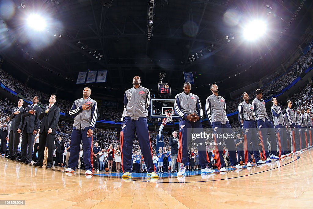 The Oklahoma City Thunder listen to the National Anthem before playing against the Memphis Grizzlies in Game Five of the Western Conference Semifinals during the 2013 NBA Playoffs on May 15, 2013 at the Chesapeake Energy Arena in Oklahoma City, Oklahoma.