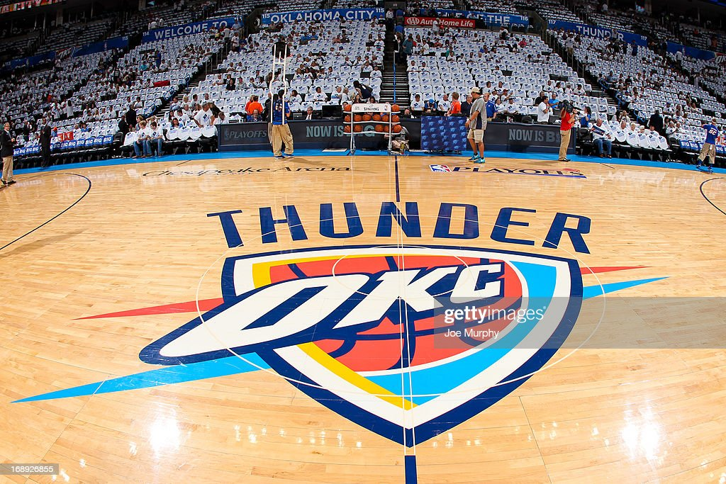 The Oklahoma City Thunder logo sits on display on the court before the team played the Memphis Grizzlies in Game Five of the Western Conference Semifinals during the 2013 NBA Playoffs on May 15, 2013 at the Chesapeake Energy Arena in Oklahoma City, Oklahoma.