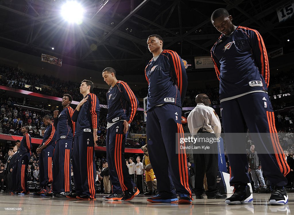 The Oklahoma City Thunder stand in respect during the singing of the National Anthem prior to the game against the Cleveland Cavaliers at The Quicken Loans Arena on February 2, 2013 in Cleveland, Ohio.