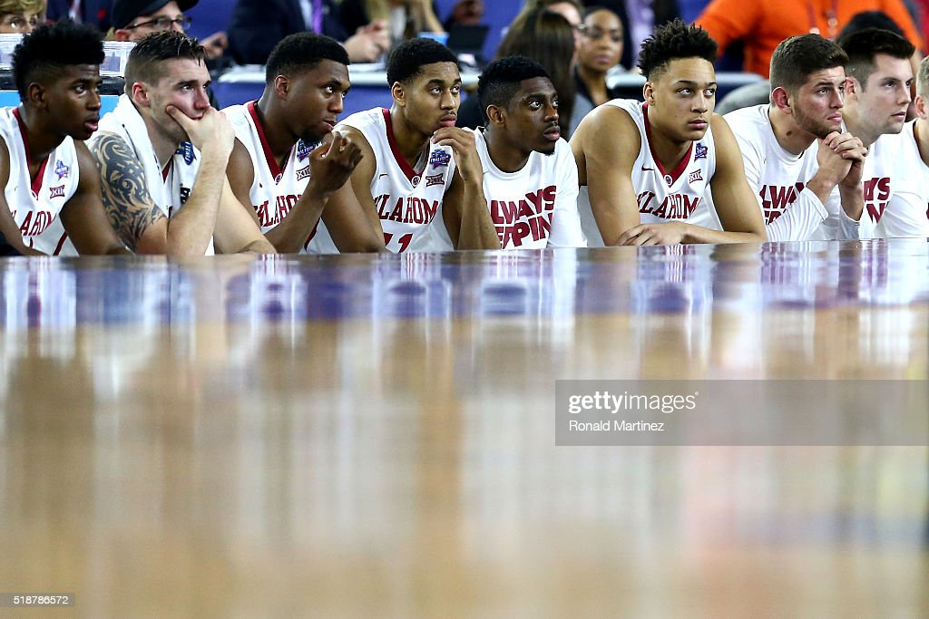 The Oklahoma Sooners bench reacts in the second half against the Villanova Wildcats during the NCAA Men's Final Four Semifinal at NRG Stadium on...