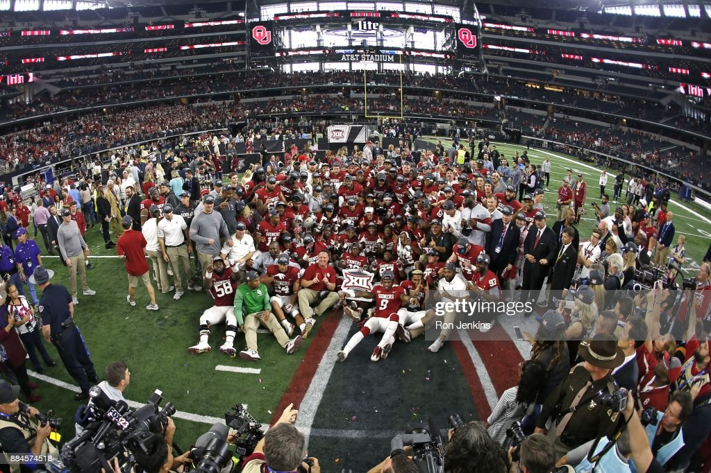 The Oklahoma Sooners celebrate with a team photo after defeating the TCU Horned Frogs 41-17 in the Big 12 Championship AT&T Stadium on December 2, 2017 in Arlington, Texas.