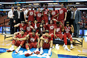 The Oklahoma Sooners pose after beating the Oregon Ducks 8068 in the NCAA Men's Basketball Tournament West Regional Final at Honda Center on March 26...