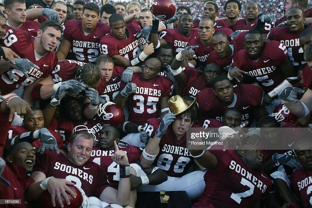 The Oklahoma Sooners pose with the Golden Hat after winning the Red River Shootout against the Texas Longhorns at the Cotton Bowl on October 12, 2002 in Dallas, Texas. Oklahoma won 35-24.