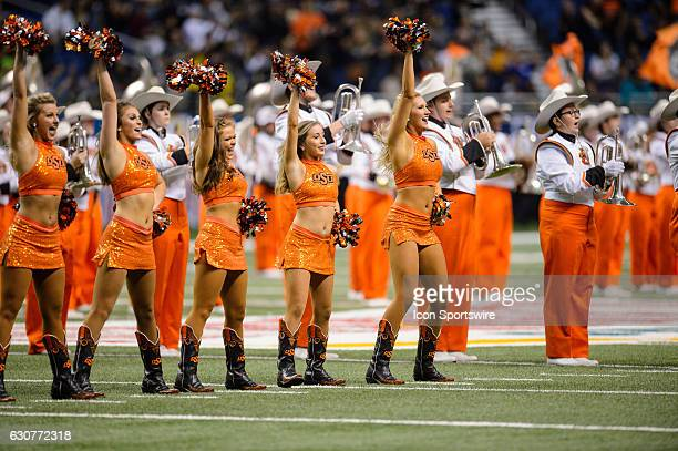 The Oklahoma State Cowboys dance team performs before the Valero Alamo Bowl between the Colorado Buffaloes and Oklahoma State Cowboys on December 29...