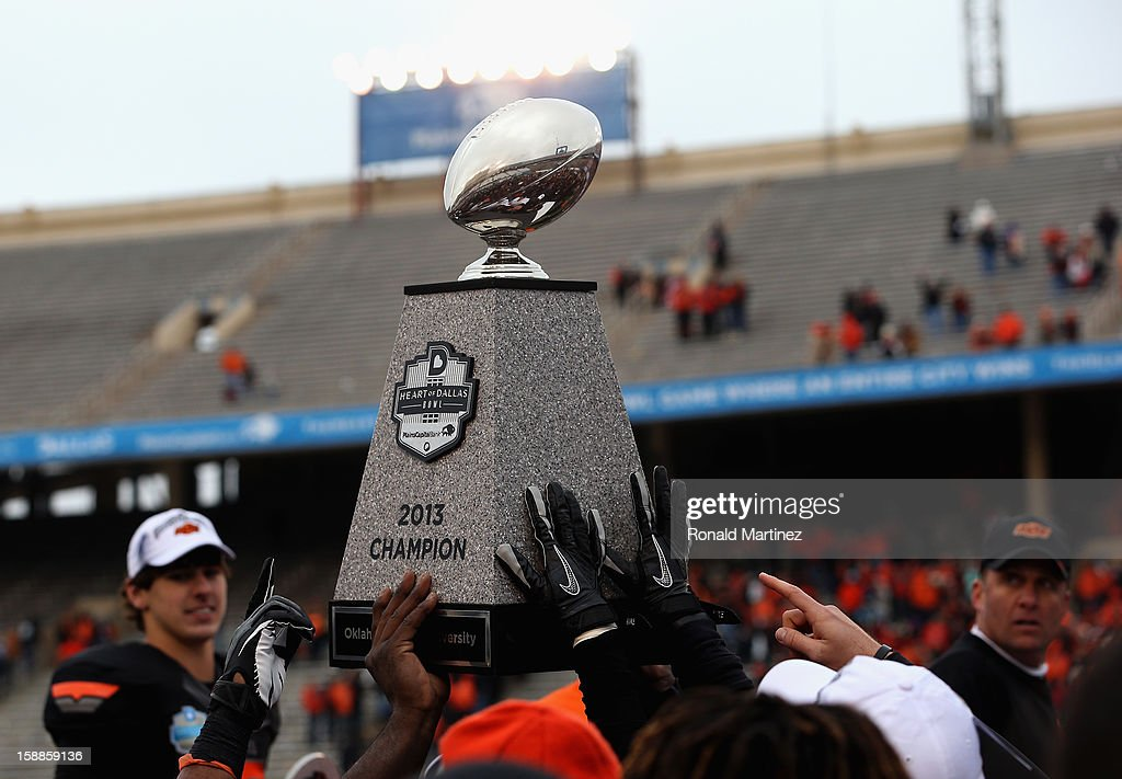 The Oklahoma State Cowboys raise the Heart of Dallas Bowl trophy after a 58-14 win against the Purdue Boilermakersduring the Heart of Dallas Bowl at Cotton Bowl on January 1, 2013 in Dallas, Texas.