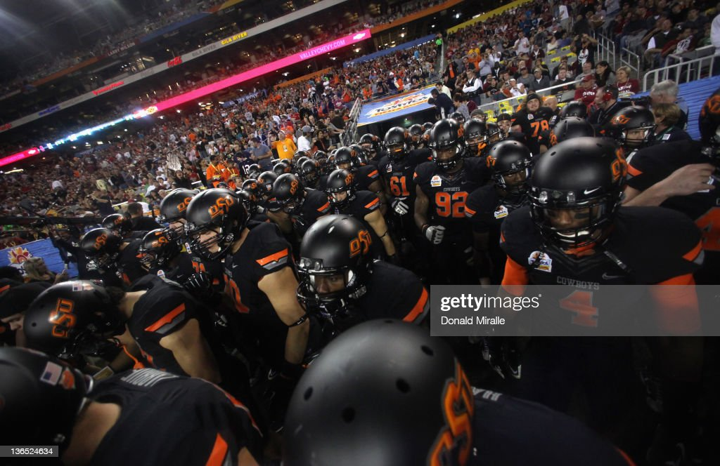 The Oklahoma State Cowboys take the field against the Stanford Cardinal during the Tostitos Fiesta Bowl on January 2, 2012 at University of Phoenix Stadium in Glendale, Arizona.