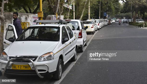 The Ola and Uber car owners parking their cabs on road near Delhi Transport Minister Satendra Jain during their protest march from Majnu Ka Tila to...