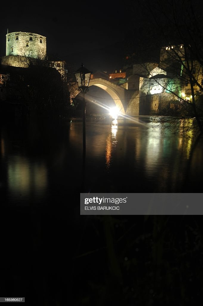 The 'Old Bridge' in the historical core of the Southern Bosnian town of Mostar, is seen while the level of Neretva river has risen approximately 3 metres in comparison to its normal summertime levels, on April 3, 2013. Water levels have dramatically risen countrywide, due to snow-melt and large quantities of rain in the past 7 days.