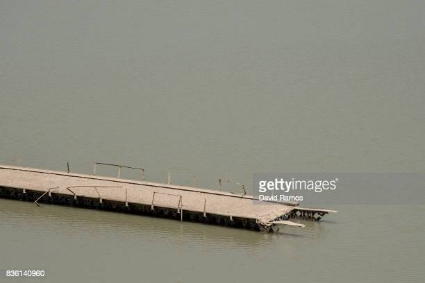The old bridge of the N204 road which use to be submerged is seen at Entrepenas reservoir second largest water reservoir feeding the Segura River and...