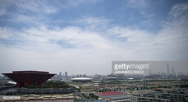 The old China Pavilion from the 2010 World Expo is seen next to the proposed site of the headquarters of BRICS development bank in the Pudong...