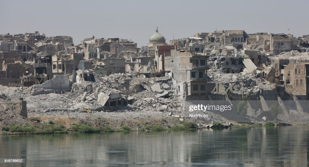 The old city of West Mosul across the Tigris by the old bridge. The neighbourhood is largely destroyed, but efforts are made to repair the old bridge that connects the old cith of West Mosul with East Mosul is ongoing. Mosul, Iraq, 13 September 2017