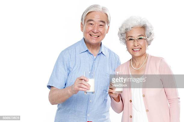 The old couple holding milk