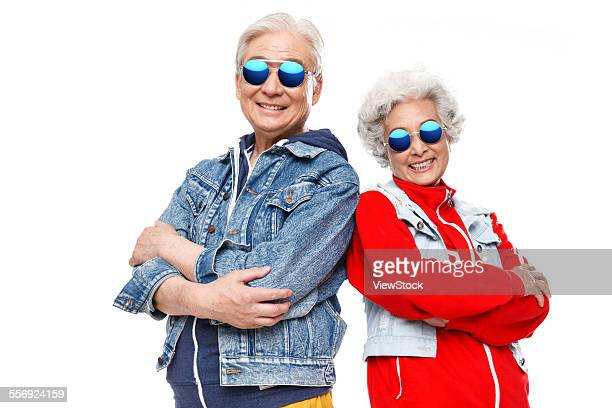 The old couple wearing sunglasses