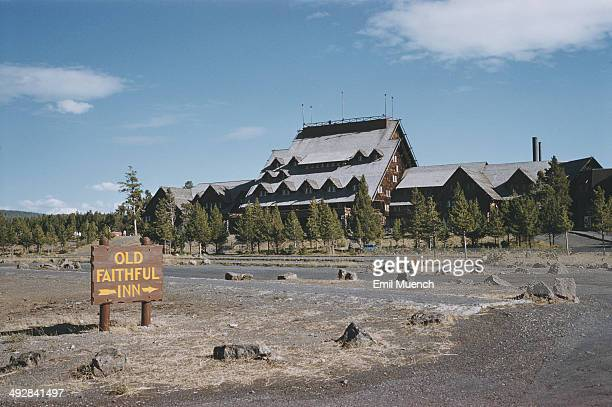 The Old Faithful Inn in Yellowstone National Park Wyoming USA circa 1965 It provides a view of the Old Faithful geyser