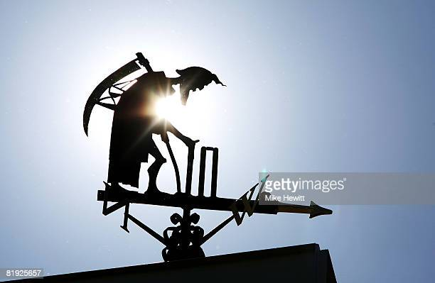 The Old Father Time weather vane is pictured during day five of the First Test match between England and South Africa at Lord's Cricket Ground on...