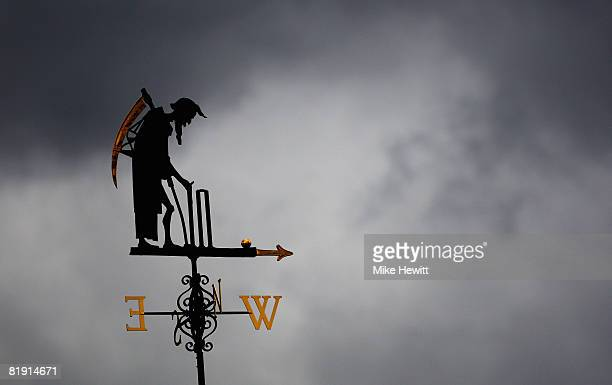 The Old Father Time weather vane is pictured during day three of the First Test match between England and South Africa at Lord's Cricket Ground on...